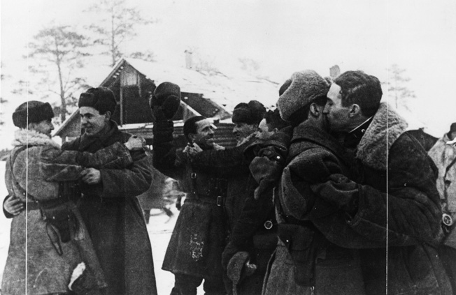 Congratulating one another on the liberation of the town of Shisselburg in January 1943, Red Army soldiers embrace. Months of hard fighting still lay ahead for the Soviets in their drive to Berlin.