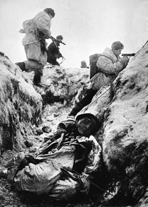A dead German lies in the foreground as Red Army troops storm an enemy strongpoint south of Lake Ladoga on November 1, 1943. Operation Spark finally facilitated the breaking of the 900-day siege of Leningrad.