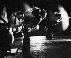 A ground crewman prepares a German Junkers Ju-88 bomber for a night attack against an English city during the Blitz.