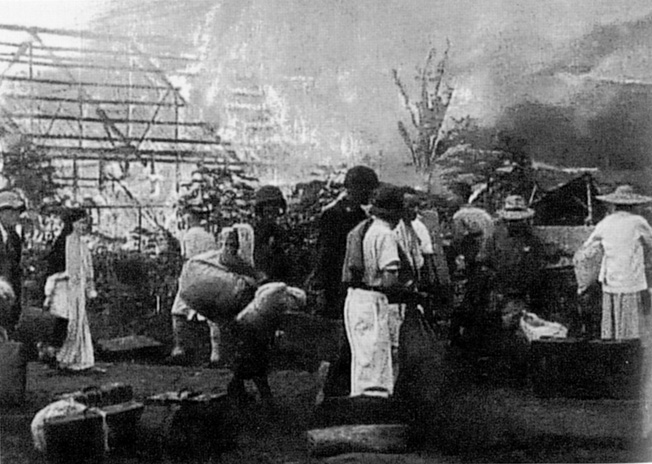 Fires rage through several barracks buildings at Los Banos as American and Filipino soldiers prepare to evacuate a number of former prisoners. Some buildings were purposely set on fire by the military personnel to encourage bewildered inmates to leave the premises with some sense of urgency.