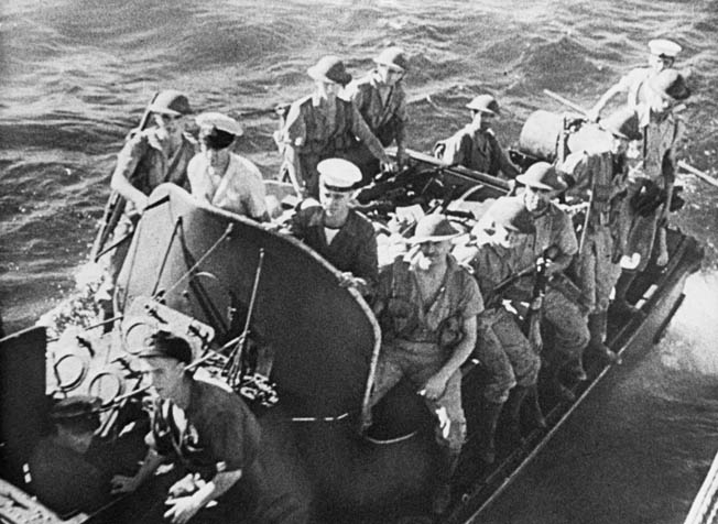 British commandos cling to the sides of a motor sailer as they prepare to assault objectives on Madagascar at the start of Operation Ironclad.