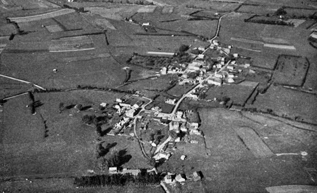 An aerial view looking north shows the small village of Marvie during more peaceful times. U.S. glider troops held on at Marvie and blunted the German drive to the key crossroads town of Bastogne during the Battle of the Bulge.