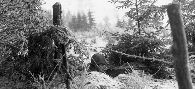 Harsh winter weather added to the misery of the defenders or Marvie. The embattled glider troops helped the 101st Airborne Division to hold on at Bastogne, where this American soldier crouched in a foxhole, and disrupt the German timetable.