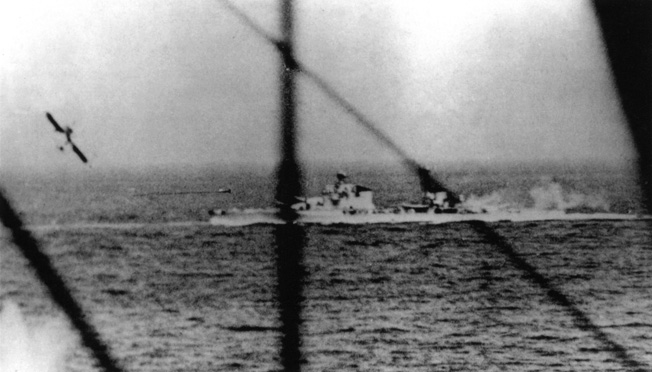A Fairey Albacore torpedo bomber pulls up after releasing its weapon toward the Italian heavy cruiser Pola. This photograph was taken from a Fairey Swordfish, another type of Royal Navy torpedo pane.