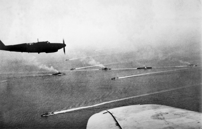 Photographed in the Ionian Sea at the time of the Battle of Cape Matapan, British warships are seen from the air. The plane in the photo is a British Fairey Fulmar.