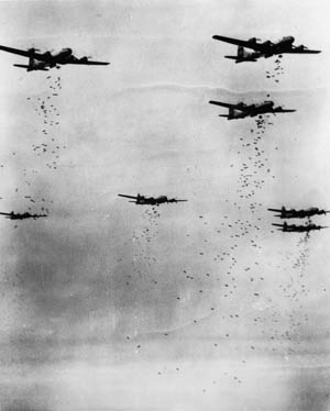 Boeing B-29 Superfortresses drop their bomb loads above a target on the Japanese home islands. Logistical problems caused the effort to be abandoned, particularly after U.S. bases on the Marianas became operational.