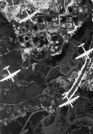 Flying above Singapore on March 2, 1945, B-29 bombers head for a target in Southeast Asia.