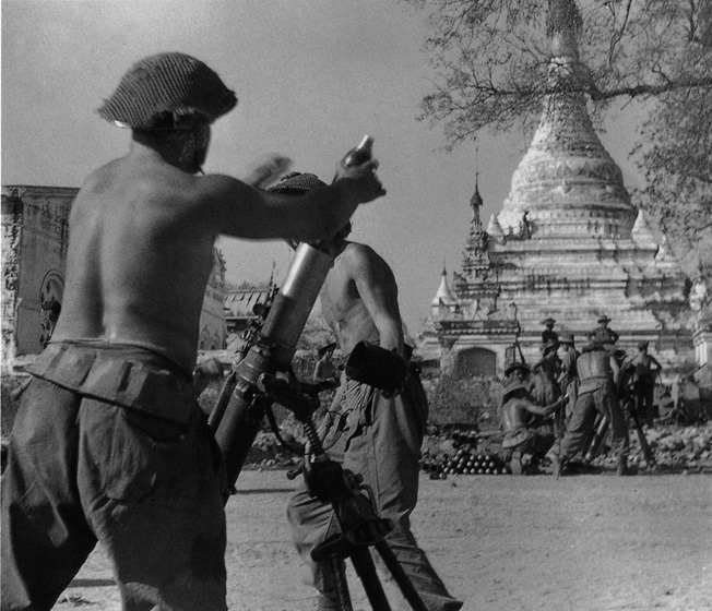 British crewmen service their 3-inch mortar during heavy fighting around Meiktila.