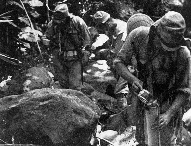 Japanese soldiers pause to gather drinking water, at times a scarce commodity, along the Kokoda Trail. Many Japanese soldiers also starved to death during the protracted fighting in New Guinea.