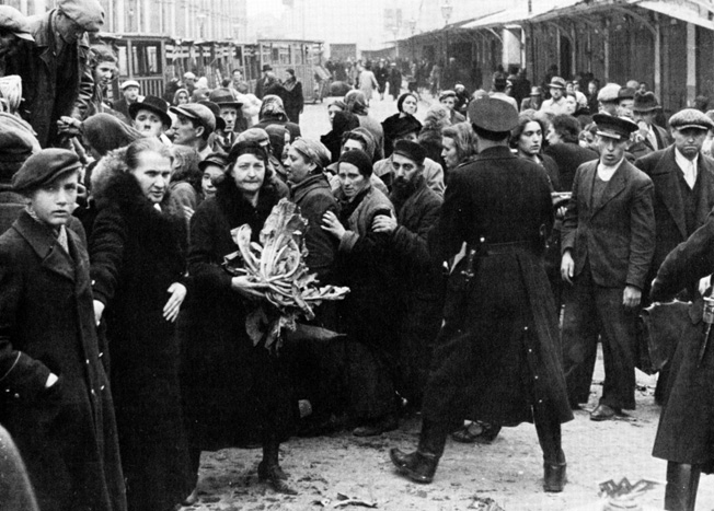 SS troops round up Polish Jews the day after Poland surrenders.