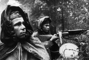 Wary Soviet infantrymen remain alert as the Germans approach defensive positions in a forest near Moscow in October 1941.