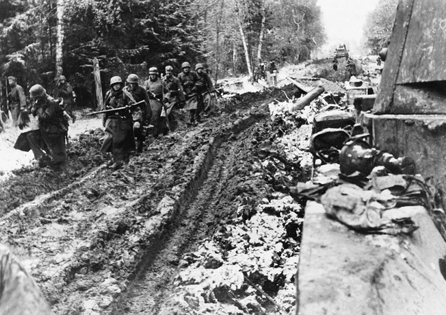 During the autumn of 1941, German SS troops slog along a muddy road near Moscow. Resolute Red Army defenders and harsh weather combined to doom the German effort to capture the Soviet capital city.