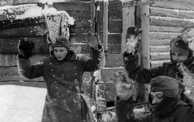 With their hands up, German soldiers capitulate to Soviet troops. Many of those Germans who surrendered during the fighting on the Eastern Front died in captivity. Others were held for years after the end of the war.