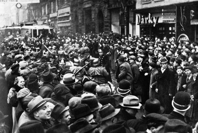 A subdued crowd in Prague watches as Germans roll into the Czech capital.