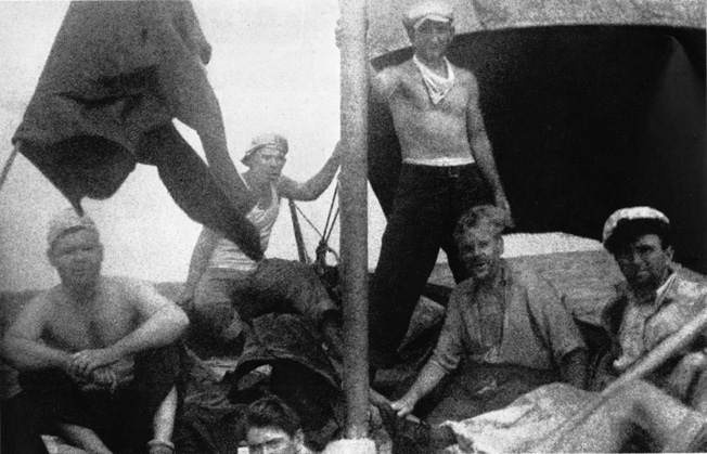 Survivors of the sunken American freighter Robin Moor pose aboard a small boat.