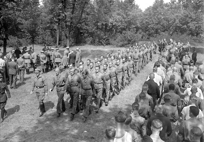 German Army recruits march in somewhat ragged ranks during a military drill in 1933. Eventually, military service became mandatory for German males ages 18 to 45.