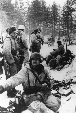 Pausing briefly during their retreat from the Red Army, exhausted soldiers of the German 18th Army may appear to be demoralized. However, plenty of fight remained in these veteran troops.