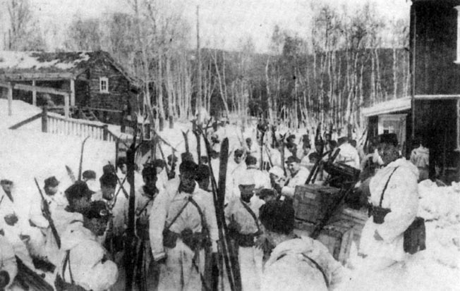 Company 6, 11th Norwegian Infantry Regiment shoulders its skis and prepares to advance toward invading German airborne troops near Dombås.