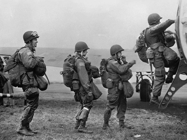 Loaded with full combat gear, these paratroopers board a Douglas C-47 transport plane in preparation for a jump. Norwood Thomas enlisted in the U.S. Army on March 16, 1942, and was assigned to the 82nd Airborne Division.