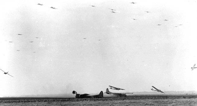On September 18, 1944, the second day of Operation Market Garden, the primary Allied airborne traffic consisted of gliders carrying troops and equipment. In this photo a serial of gliders is coming to rest at Landing Zone W.
