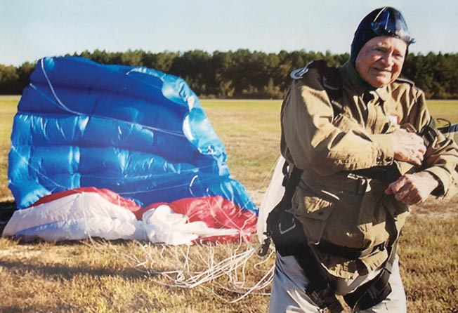 Norwood Thomas steps away from the spot where he safely landed during a parachute jump at the age of 88, his first since D-Day. Since that time he has jumped on several other occasions, setting a record with Skydive Suffolk in October 2017 at age 95.