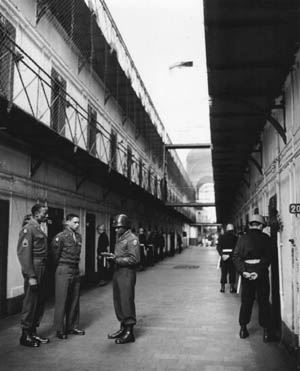 U.S. soldiers were ordered to keep a watchful eye on the prisoners inside the Palace of Justice. Howev- er, in spite of such orders, Robert Ley, head of the Nazi Labor Front, successfully committed suicide. Following Ley's suicide, guards were posted at each cell and watched the prisoners 24 hours a day.