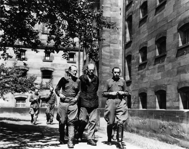 During one of their short exercise periods, prisoners on trial at Nuremberg walk and talk inside the prison courtyard. Although they were officially forbidden to confer, the guards often allowed them to talk quietly.