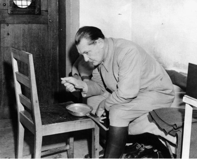 Former head of the German Luftwaffe Hermann Göring eats alone in his cell in the Palace of Justice at Nuremberg. He was able to take poison on the night he was scheduled to hang for war crimes.
