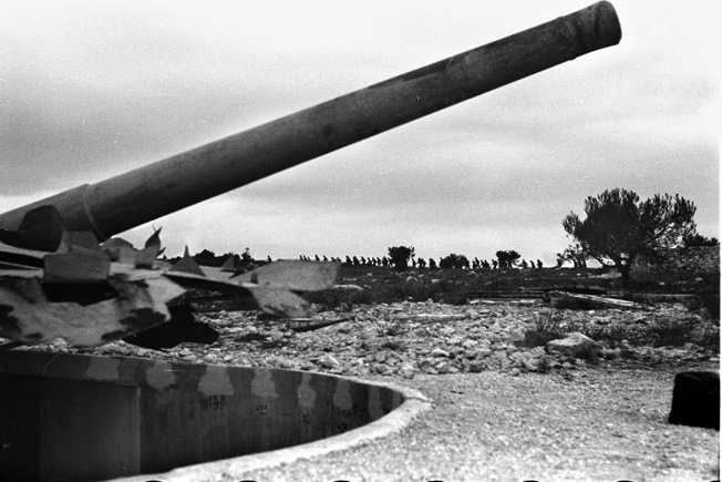 Photographed during an inspection in 1942, this heavy German coastal gun was intended to deter and then repel any attempt by the Allies to land troops in southern France.