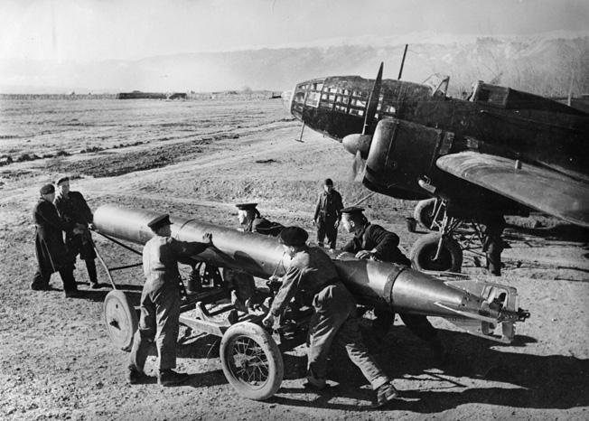 Black Sea Fleet. Soviet ground crew loading a torpedo onto an Il-4 medium bomber.