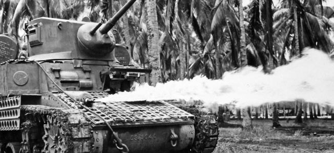 This Stuart light tank is shown with an M1A1 flamethrower mounted in the ball turret where a machine gun had originally been placed. In the autumn of 1943, U.S. Army and Marine Corps battalions on New Caledonia began the effort to adapt flamethrowers to their tanks.