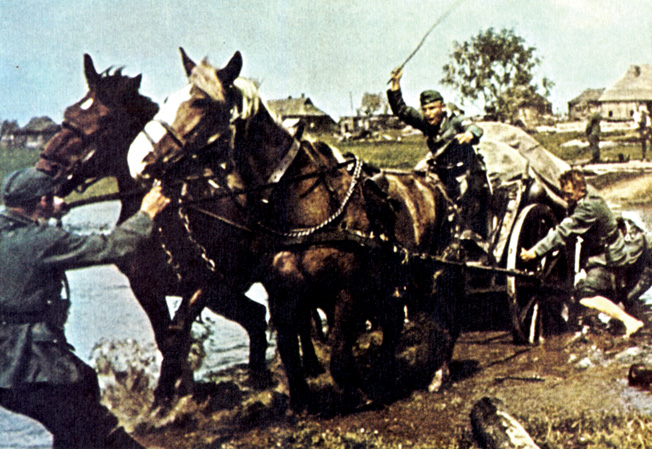 Mired in mud up to the axles, a German supply wagon is caught in the quagmire of a Russian road. Soldiers attempting to push, pull, and exhort the pair of horses drawing the wagon to extricate it from the trap caused by the spring snow thaw and heavy rain.
