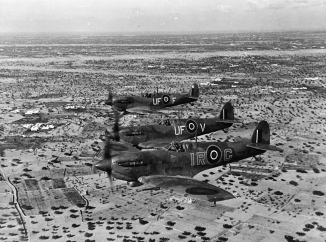 Off the coast of De Djerba island, a formation of RAF Spitfire fighters patrols near the Mareth Line in North Africa. The Spitfire served in all theaters of World War II and a naval version, the Seafire, was also developed.