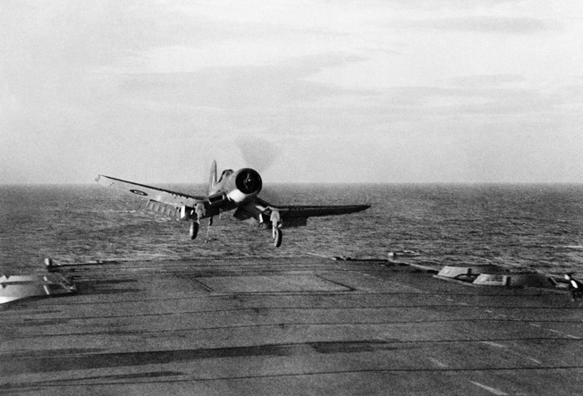 An F4U Corsair comes in for a landing aboard an aircraft carrier in the Pacific. Although its early trials as a carrier-based fighter revealed some problems, the Corsair was eventually adapted to operations aboard carriers and proved to be a fine dogfighter and ground-support aircraft.