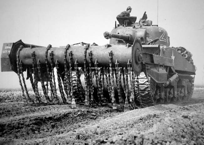 The Sherman Crab featured a rotating cylinder with weighted chains designed to detonate mines for follow-on forces.