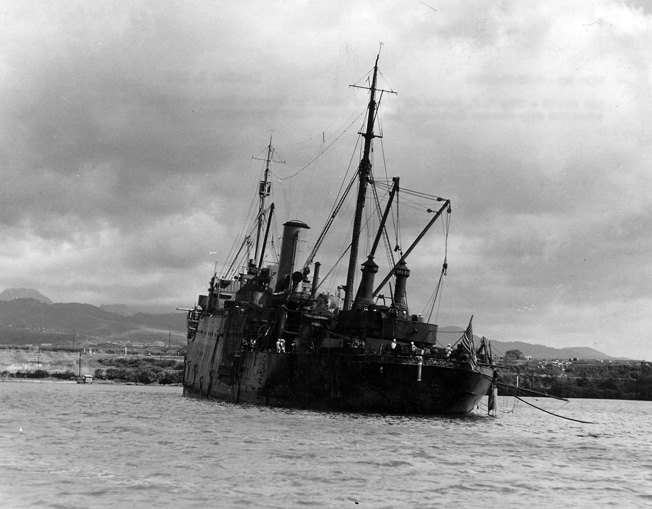 After being twice bombed by Japanese fliers, the USS Vestal sits beached following flooding triggered from the damage she sustained.