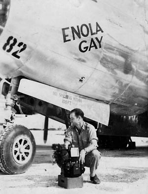 Major Thomas Ferebee is shown with the Norden bombsight he used to aim the atomic bomb from the Enola Gay above Hiroshima on August 6, 1945.
