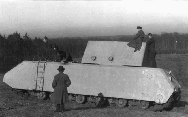 The prototype has a weight in place of the 50 ton turret. BELOW: