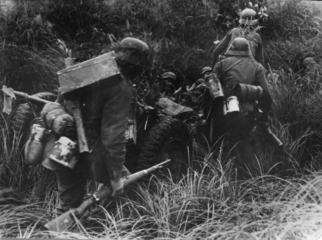 During a counterattack near Orel on the Eastern Front, a German soldier is seen carrying his trusty Mauser bolt action. The reliable Mauser was exported to numerous countries and is still in use today.
