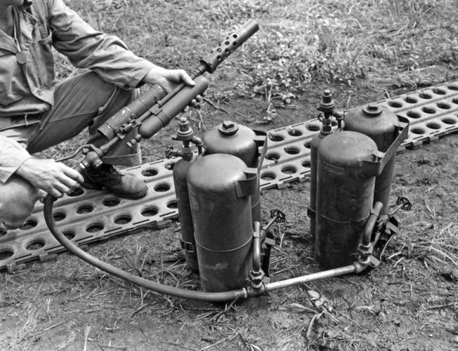 The flamethrower tanks on New Caledonia used two M1A1 fuel cylinders as depicted in this photo. One of these was placed on the floor of the tank in front of the bow machine gun position, and the other was behind the machine gunner's seat.