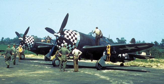 Ground crewmen prepare the P-47 Thunderbolt fighters of the 78th Fighter Group at Duxford, United Kingdom, where the group was based in 1944.