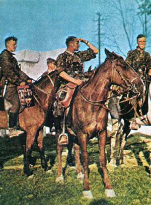 Waffen SS cavalrymen, members of one of two regiments that were formed into a brigade in the summer of 1941, appear cheerful and relaxed astride their mounts.