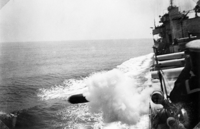 A torpedo exits a portside tube of the HMAS Vendetta, which is in action against Axis forces in the Mediterranean in 1940.