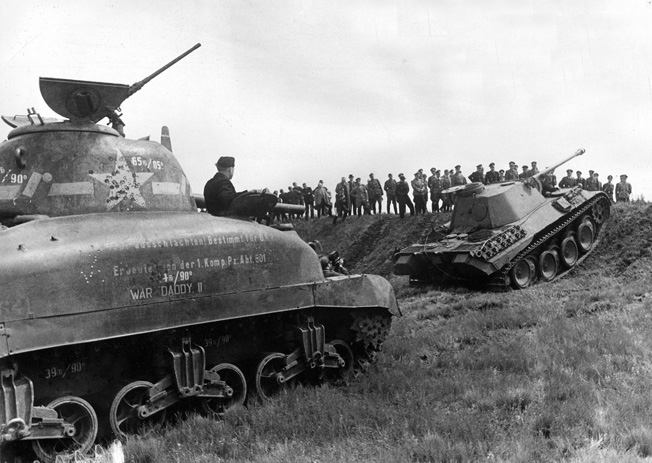 WORLD WAR II: TANK TESTING. While overcoming obstacles, a captured U.S. M4 'Sherman' tank is compared with a German 'Panzer' tank. Photograph, 1944.