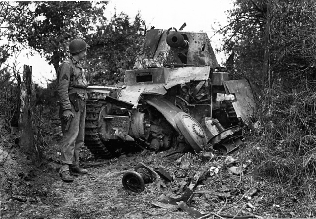 An American soldier inspects the hulk of a Model M Marder that has been disabled by a direct hit against its chassis from an Allied artillery shell.