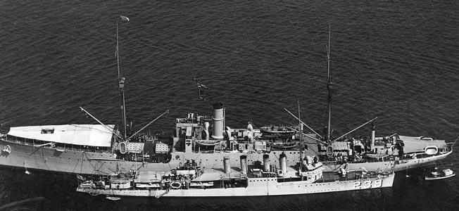 The Vestal assists a U.S. Navy destroyer.