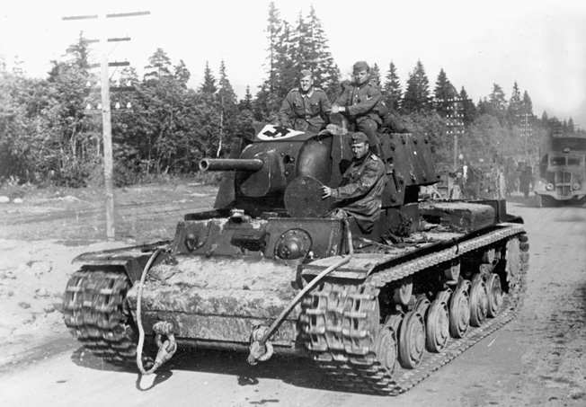 WORLD WAR II: SOVIET TANK. German soldiers on route to Leningrad, Russia, with a captured Soviet KW-1 Panzer tank. Photograph, 1941.