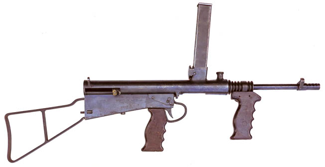The view of the Owen gun above reveals the relatively few major parts that were fabricated to  complete the assembly of the automatic weapon.