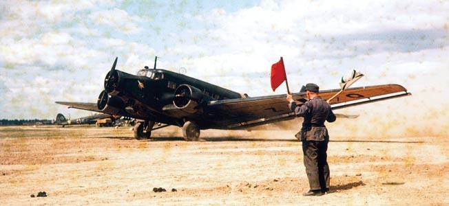 """COL - Transportflugzeug Junker Ju - 52 auf einem Flugfeld ohne weitere Angaben 1944 Foto: Walter Frentz   """""""" cargo plane Junker JU - 52 on an airfield no further details - 1944 Photograph by Walter Frentz"""