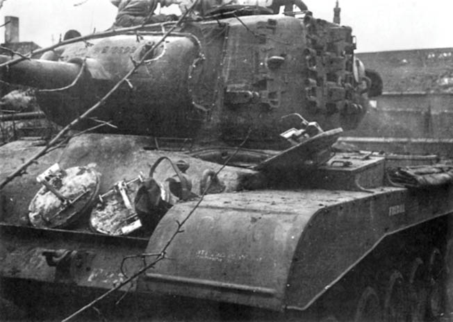 Photographed after it was recovered from the battlefield, the M26 Pershing tank nicknamed Firefly was the first of its kind knocked out during World War II.
